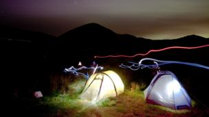 Tents lit up at night