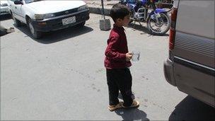 Girl disguised as boy selling water in Kabul