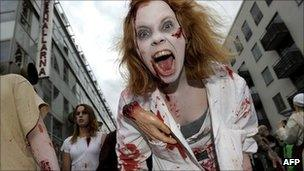 """People dressed as zombies take part in a """"zombie walk"""" in Stockholm, Sweden - 12 June 2010"""