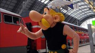 A person in Asterix costume at Frankfurt train station