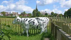 A digital cow in a Sussex field.