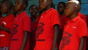 "Children in Uganda wearing ""Pray to end child sacrifice"" t-shirts"