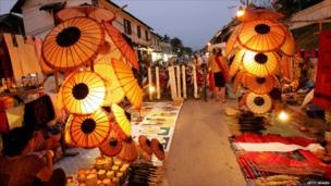 Handicraft vendors wait for customers at the night market of Luang Prabang.