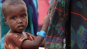 A child waits in the registration area of the Ifo refugee camp which makes up part of the giant Dadaab refugee settlement in Dadaab, Kenya