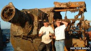 Hector Bado and Dr Mensun Bound celebrate the recovery of the Graf Spee's rangefinder off the coast of Uruguay