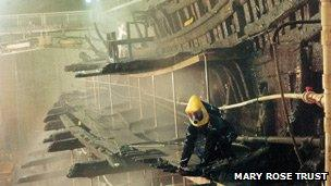 A restorer works on the Mary Rose wreck