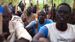 Recruits for the Sudan People's Liberation Army (SPLA) train in a secret camp in the Nuba mountains of South Kordofan 11 July 2011.