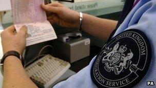 A passport being checked at an airport
