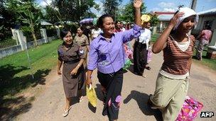 Female prisoners walk out of the Insein central prison on 12 October