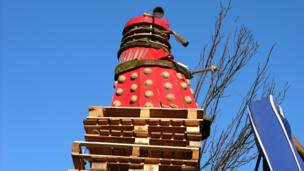 Dalek on top of wooden pallets