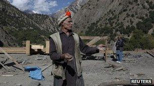 A village leader Palawan, 60, works on the reconstruction of a Kalash festival site in Grom village located in Rumbur Kalash valley October 12, 2011, as part of a project run by the Norwegian Chitral Integrated Area Development Organisation.