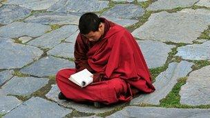 A monk meditates at a monastery in Sichuan province on 23 March 2008