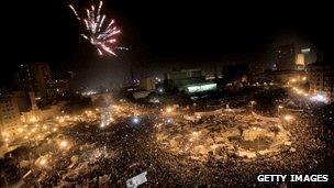 Protesters in Tahrir Square, Cairo, celebrate as Egyptian President Hosni Mubarak steps down, 11 February 2011