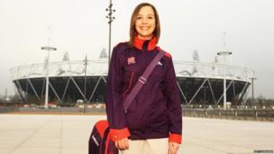 Helen, a Games Maker volunteer, models the new uniform outside the Stratford Olympic Stadium.