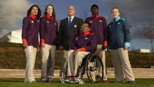 The Games Maker's and technical volunteers model their new uniforms for the London Olympics.