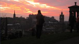 People taking photos on Calton Hill at sunset