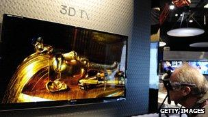 A man looks at a 3D television