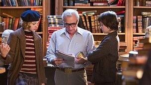 Chloe Moretz, Martin Scorsese and Asa Butterfield on the set of Hugo