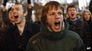 Opposition protesters shout slogans in Moscow, 6 December