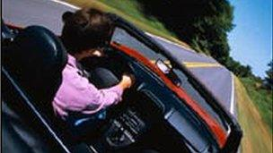 Man driving open top car