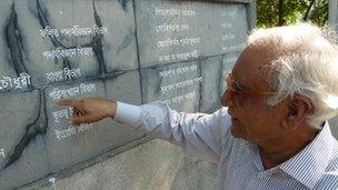 Professor Serajul Islam Choudhury points at names on a memorial wall at Dhaka University