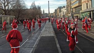 Santa fun run on Princes Street, Edinburgh