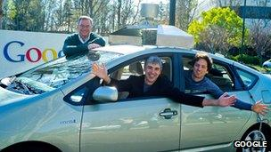 Google's executive team with one of their self-drive cars