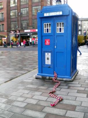 Blue police box in the street