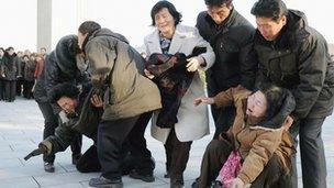 Pyongyang residents upset at the news of Kim Jong-il's death on 19 December 2011