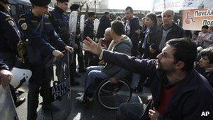 Wheelchair users join a protest rally in central Athens (13 Dec)