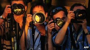 Press photographers at work