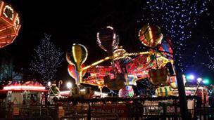 Carousel ride lit up at night