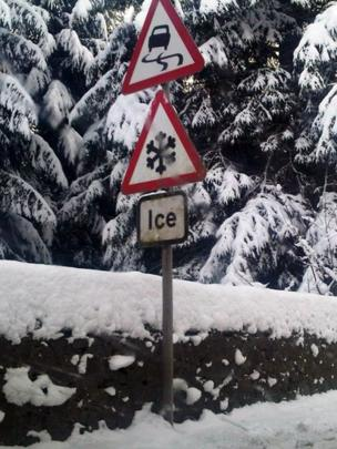 Road signs for snow and ice