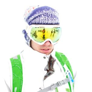A man wearing a ski outfit