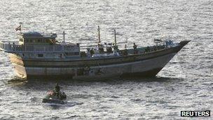 US Navy sailors board the Al-Molai
