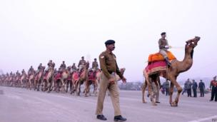 Soldiers and camels in procession