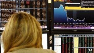 A trader checks financial data on a terminal