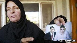 File image of Maliya Abdul Hamid Hassan Ali shows wedding picture of her brother Rasheed who died in US Marines raid.
