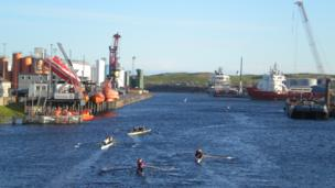 People rowing in Aberdeen harbour