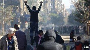 Barricade erected by protesters facing riot police near Cairo's Tahrir Square on 5 February 2012