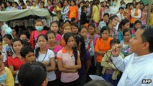 Workers protesting outside a factory in Cambodia