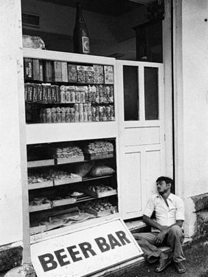 Sleeping man outside a bar (Photo: Pablo Bartholomew)