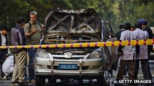 Police inspect the wrecked Israeli embassy vehicle, 13 Feb