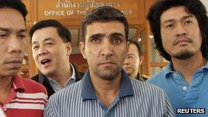 Police parade suspect Mohammad Khazaei at the immigration bureau