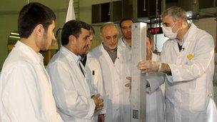 President Mahmoud Ahmadinejad (second from left) on a tour of Tehran's nuclear facilities on 15 Feb 2010