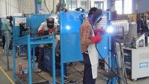 Staff at work at Sharada Motor Industries plant