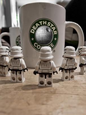 A coffee mug and toy figures