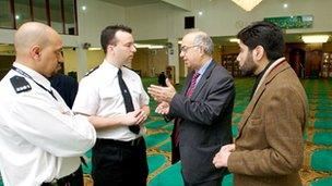 Police officers meeting with mosque members