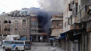 Smoke rising from building in Homs