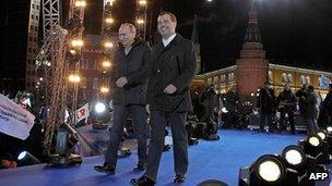 Vladimir Putin (L) and outgoing President Dmitry Medvedev at a victory rally near the Kremlin (4 Mar 2012)